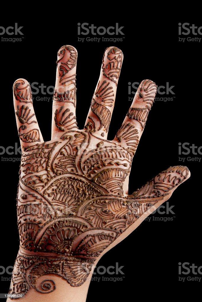 Henna (Mehndi) on a little girl's hand stock photo