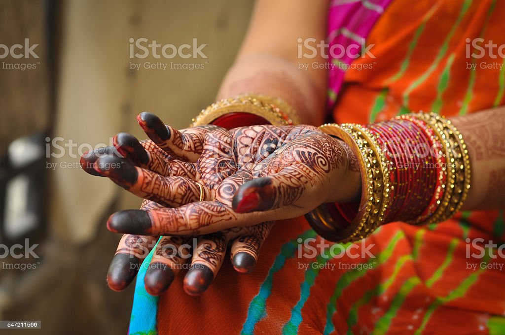 Henna on hands of Indian Woman with bangles stock photo