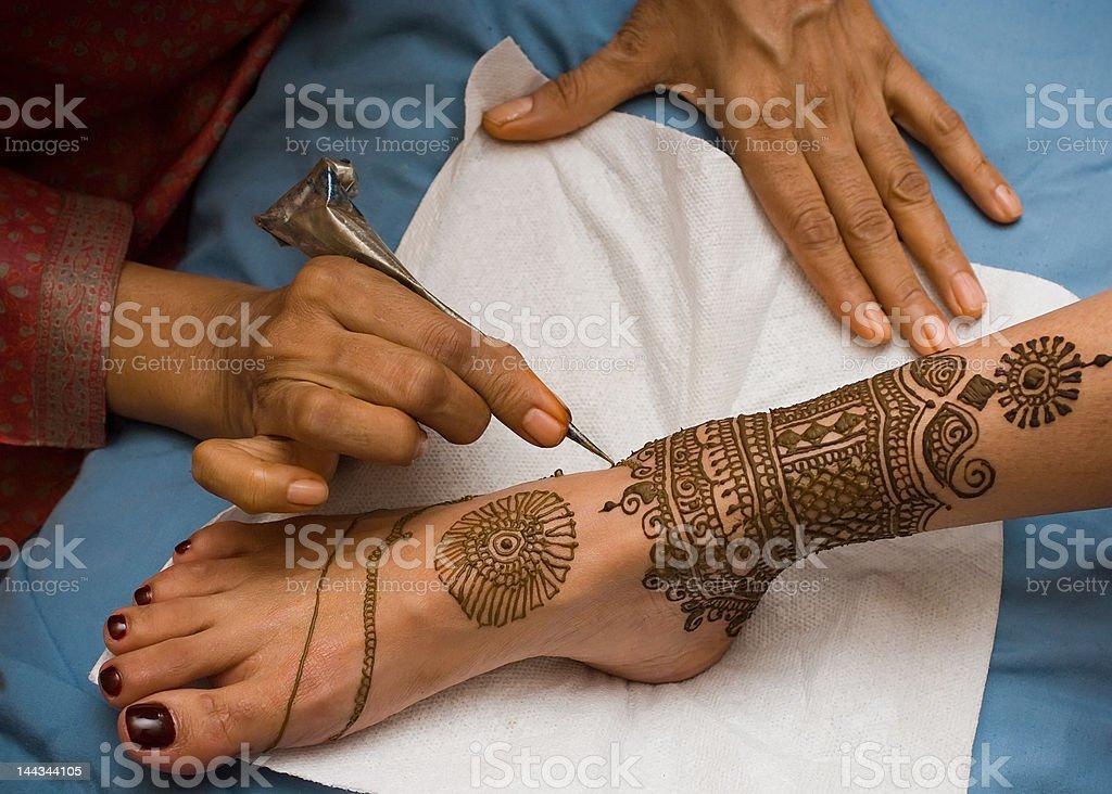 Henna session stock photo