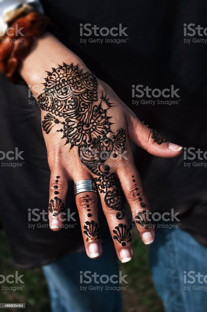 Henna tatto on woman's hand trendy floral design stock photo