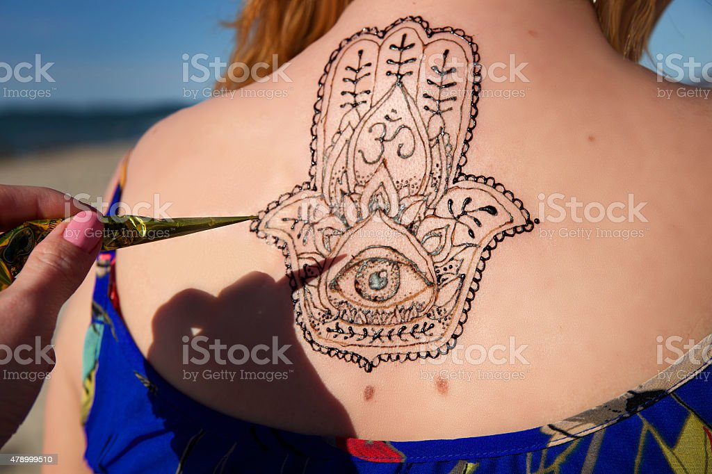 henna tattoo mehendy painted on back hamsa stock photo