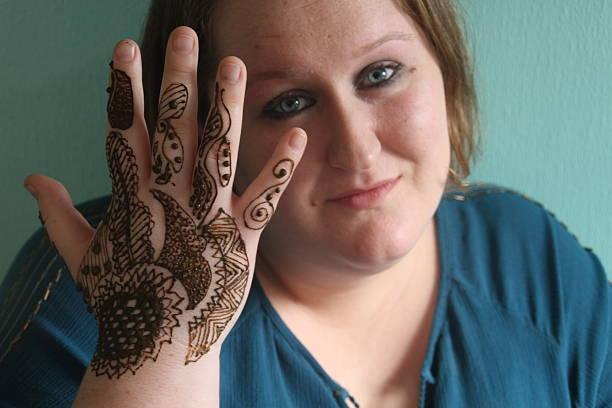 Henna Tattoo on Woman stock photo