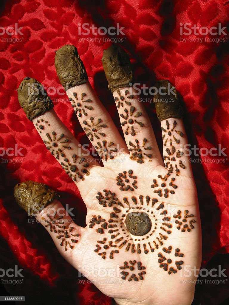 Hennaed hands royalty-free stock photo