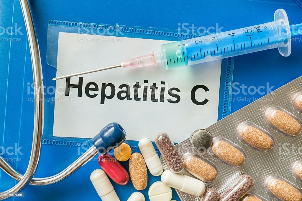 Hepatitis C disease concept. A lot of drugs and pills. stock photo
