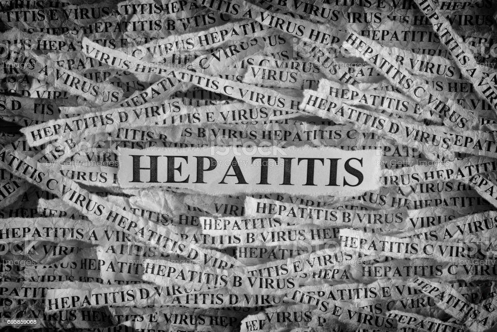 Hepatitis. Torn pieces of paper with the words Hepatitis stock photo