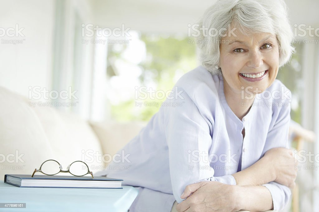 Her afternoon routine involves a good book stock photo