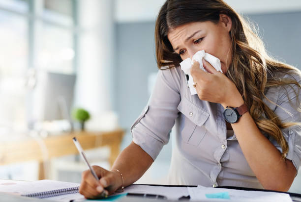 Her allergies are keeping her from being productive stock photo