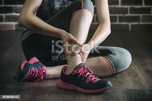 istock her ankle injured in gym fitness exercise training, healthy 609699442