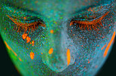 Shot of a young  woman posing with neon paint on her facehttp://195.154.178.81/DATA/shoots/ic_784268.jpg