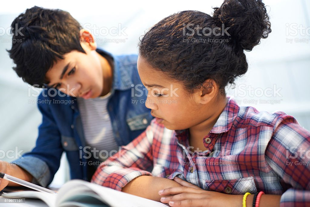 Her big brother is always there to help stock photo