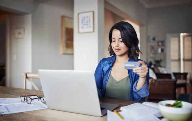 Her bills are always paid on time stock photo