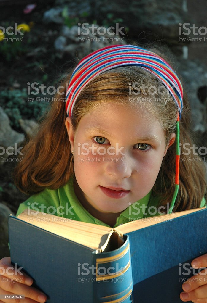 Her book royalty-free stock photo