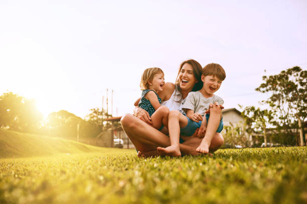 Her boys fill her life with joy Cropped shot of a young family spending time together outdoors grounds stock pictures, royalty-free photos & images