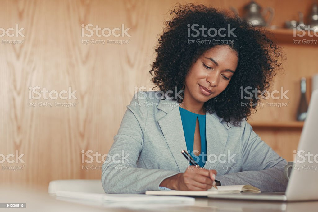 Her caliber of work is top notch stock photo