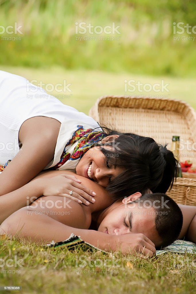 Her cheek on his shoulder stock photo