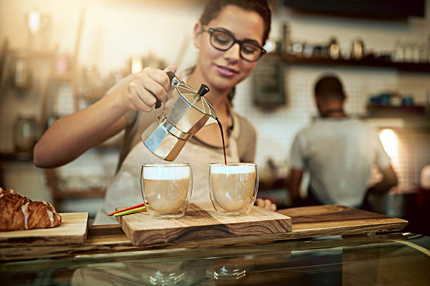 her coffee is worth the trip just for a sip - barista making coffee stock photos and pictures