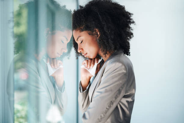 Her emotions are building up Shot of a young businesswoman looking stressed out in an office crying stock pictures, royalty-free photos & images