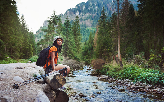 Shot of a young attractive woman hiking in nature