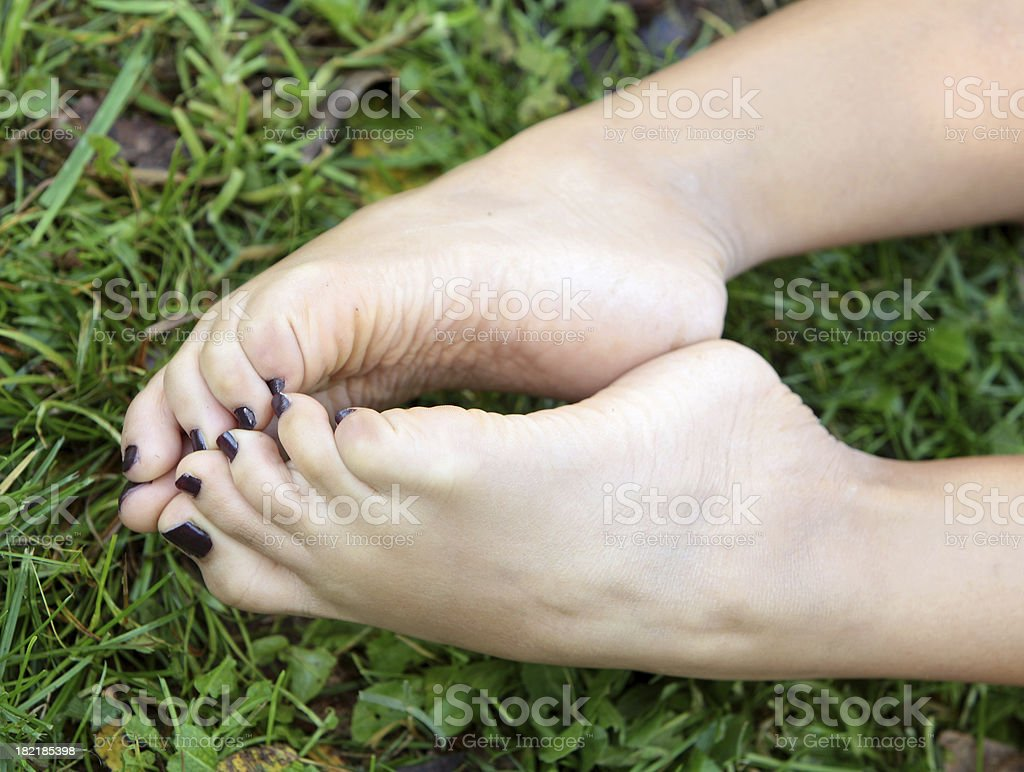 Her feet on grass royalty-free stock photo