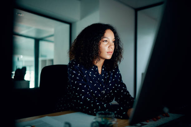 Her focus is right on the deadline stock photo