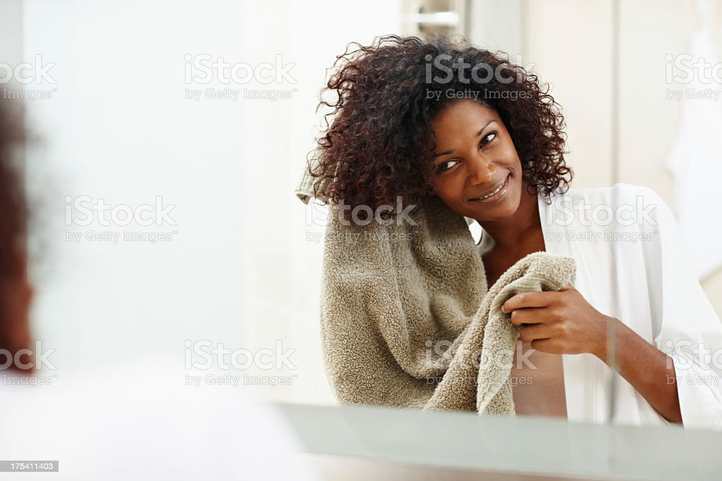 Her hair product gets the job done everytime - Haircare stock photo