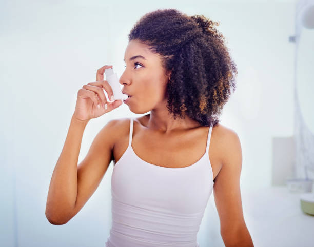 Her inhaler makes all the difference stock photo