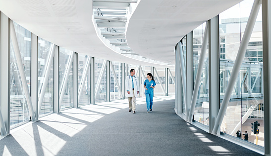 Shot of two healthcare workers walking together
