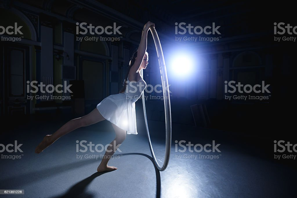Her life is circus. Woman rotate on cyr wheel. stock photo