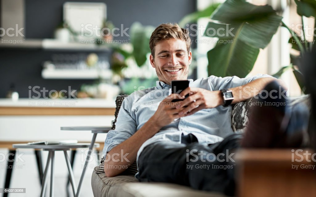 Her messages always make him smile stock photo
