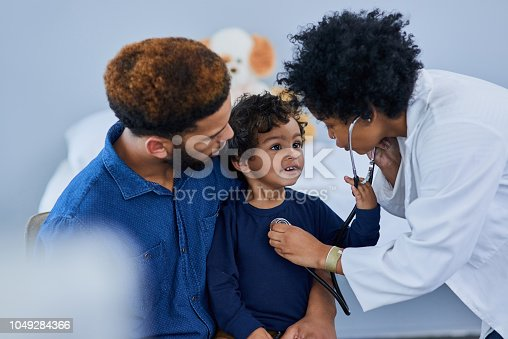 Shot of a female doctor checking her young patient's heart rate