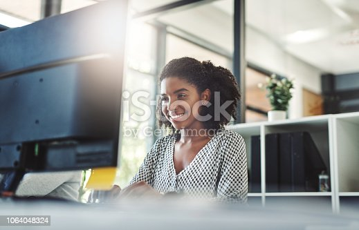 Cropped shot of a young businesswoman working on her computer at her desk