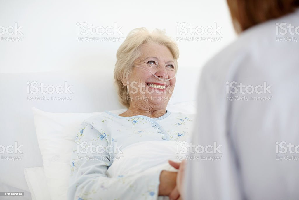 Her positive outlook helps with the healing - Senior Care stock photo