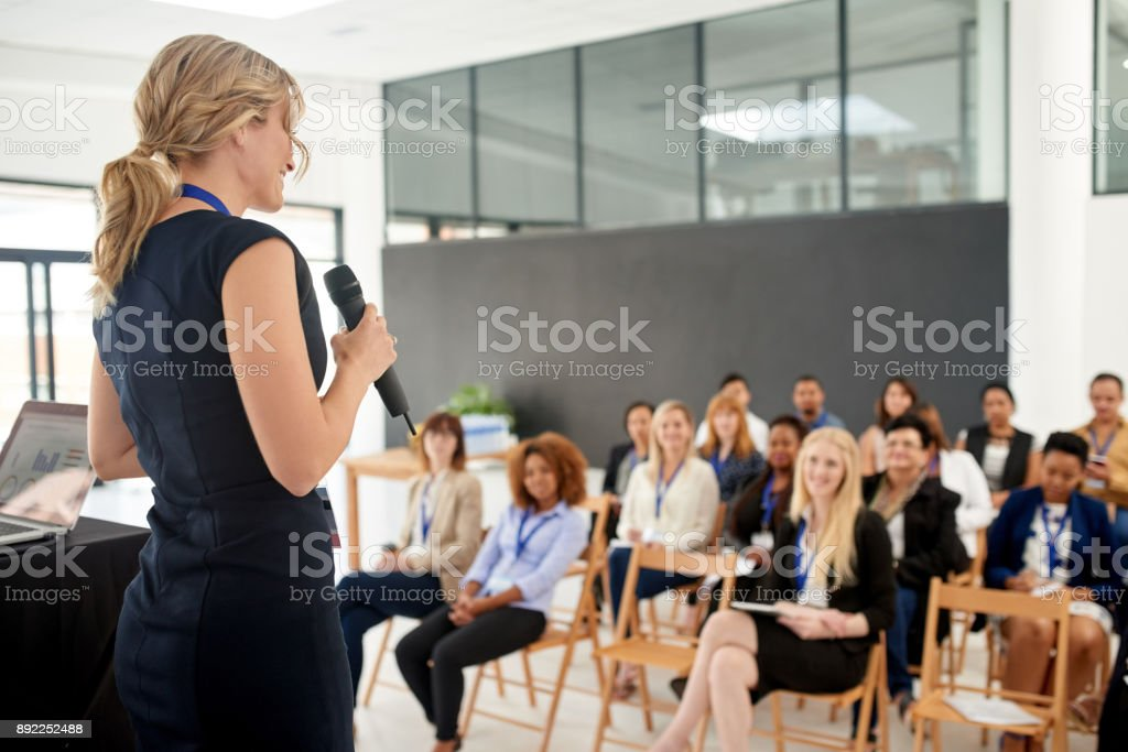 Her presentation leaves an impact on her colleagues stock photo