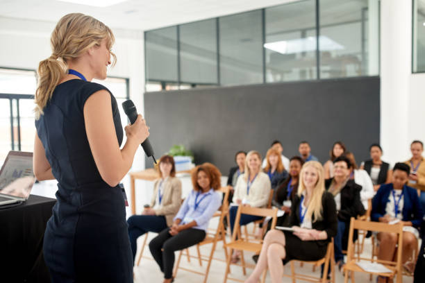her presentation leaves an impact on her colleagues - train stock photos and pictures