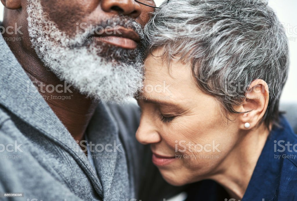 Her safest place is in his arms stock photo
