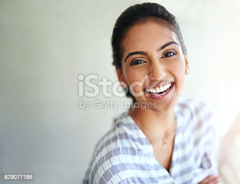629077968istockphoto Her smile, filled with positivity 629077186