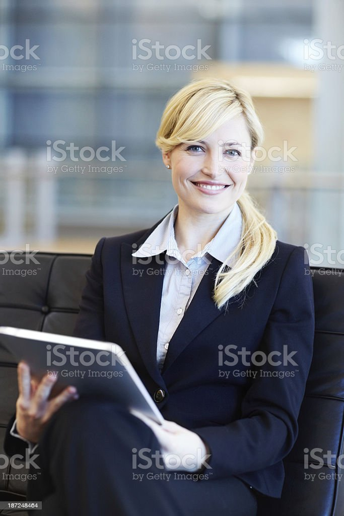 Her tablet is an indispensable tool stock photo