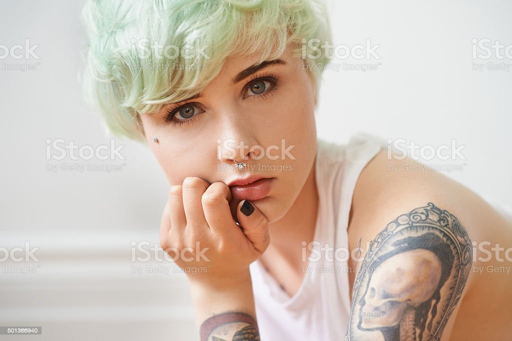 Her tattoos are more than just skin deep stock photo