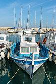 Heraklion, Greece - November 12, 2019: Wooden fishing boats in port of Heraklion, Crete Island, Greece
