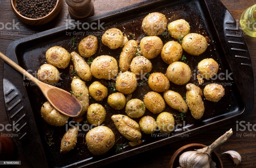 Herb and Garlic Roasted Baby Potatoes stock photo