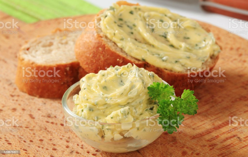 Herb butter in a fish and on fresh sliced bread royalty-free stock photo