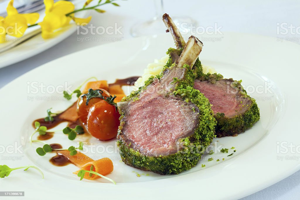 Herb crusted rack of lamb stock photo