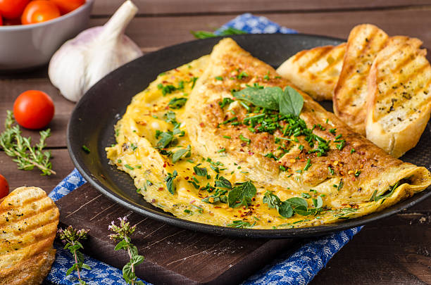 Herb omelette with chives and oregano stock photo