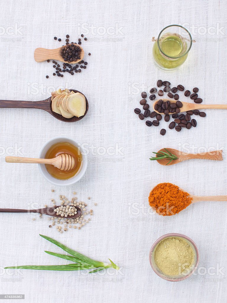 herb variety on rustic background from top view, oil, coff stock photo