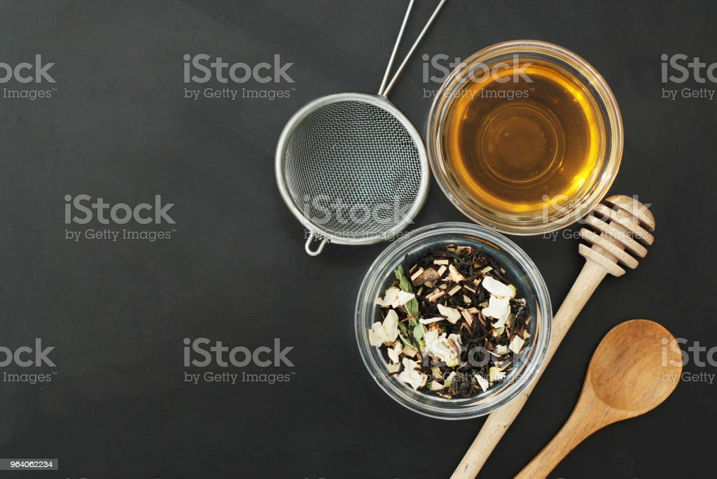 Herbal Acaccia Tea Healthy Drink in bowl and sieve over Black Background copy space. Healthy Drink, coldness. - Royalty-free Above Stock Photo