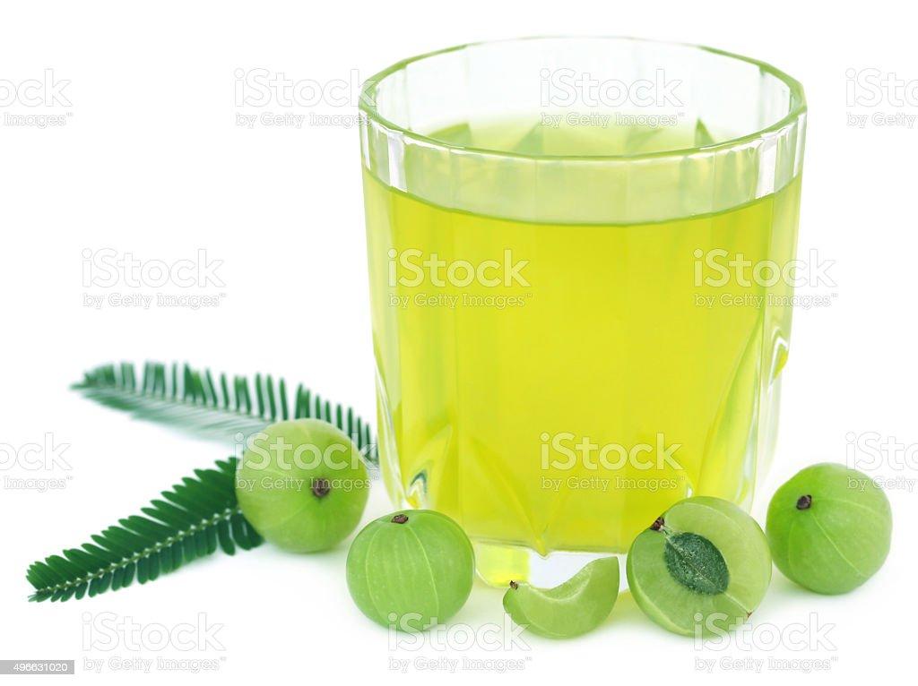 Herbal amla juice with fresh fruits stock photo