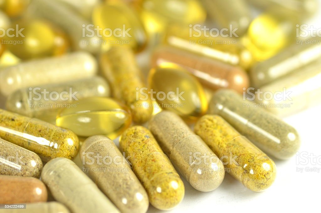 herbal capsules and fish oil capsules isolated on white background stock photo