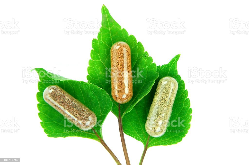 herbal capsules on sage leaves royalty-free stock photo