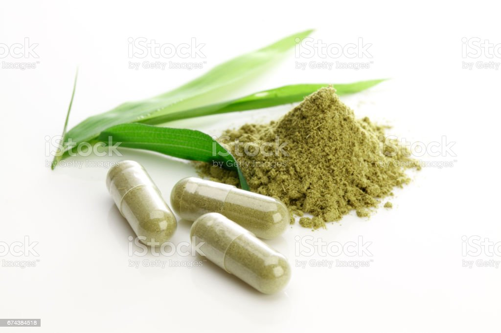 Herbal capsules on white stock photo