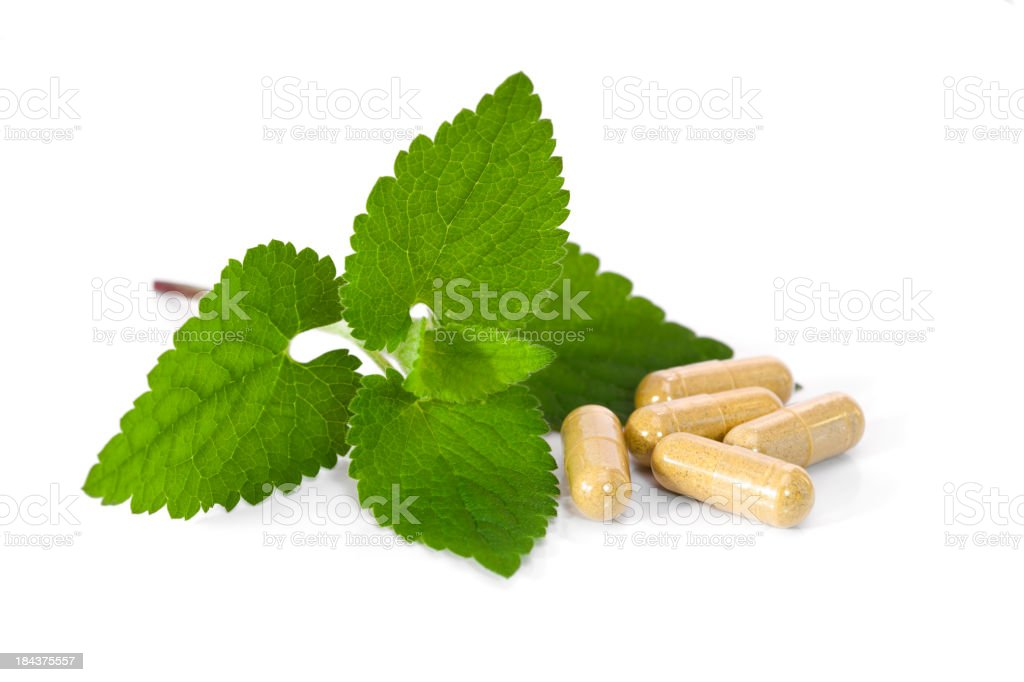 Herbal capsules with lemon balm. royalty-free stock photo